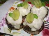 Recipe Button mushrooms stuffed with minced meat with lemon basil and grapes.