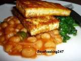 Recipe Marinated tofu-paneer(indian cottage cheese) on a bed of wilted spinach and baked beans