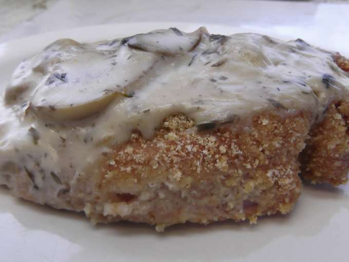 Baked breaded pork chops with mushroom cream sauce