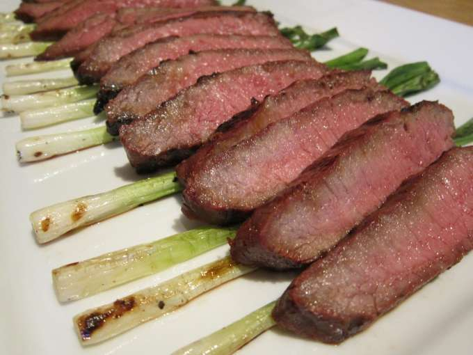 Ginger-soy flatiron steak with grilled green onions (visit site!)
