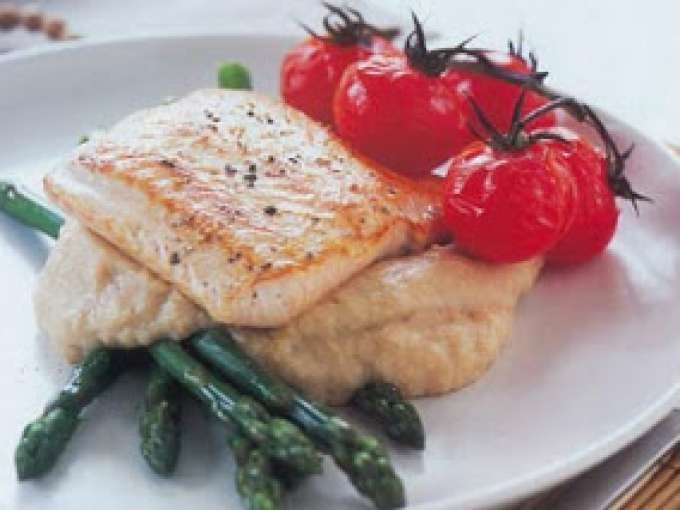 Salmon with garlic bean puree, asparagus and tomatoes