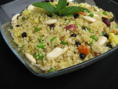 Quinoa pilaf with berries and soaked almonds