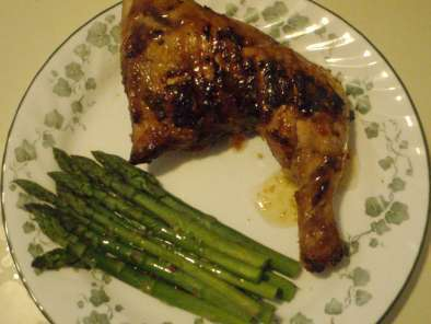 Grilled chicken leg quarters with asparagus