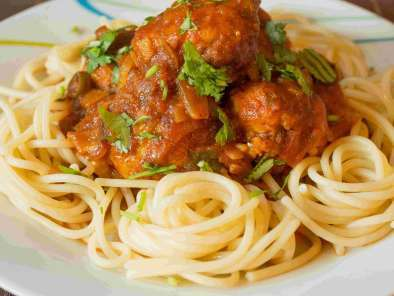 Chicken meat balls asian style over spaghetti