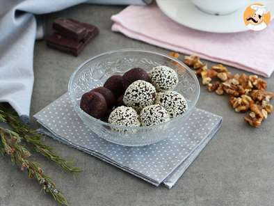 Dates and chocolate energy balls with sesame seeds