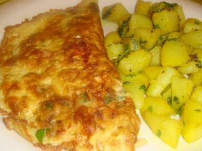 Recipe Cheese egg omelette with a side of fried potatoes