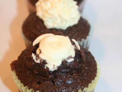 Recipe Chocolate cupcakes with volcano style orange icing