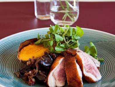 Recipe Duck breasts with dry-roasted sweet potatoes, watercress & balsamic prunes & onions