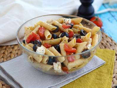 Pasta salad, with tomato, feta cheese and olives