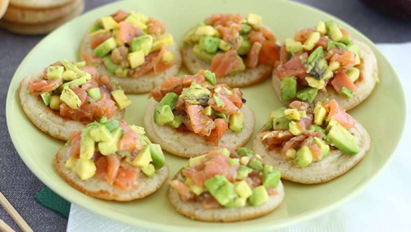 Avocado and salmon blini appetizer